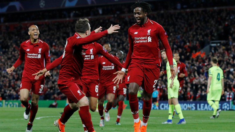 """""""Liverpool"""" futbolisti līksmo par vārtu guvumu. Foto: Reuters/Scanpix"""
