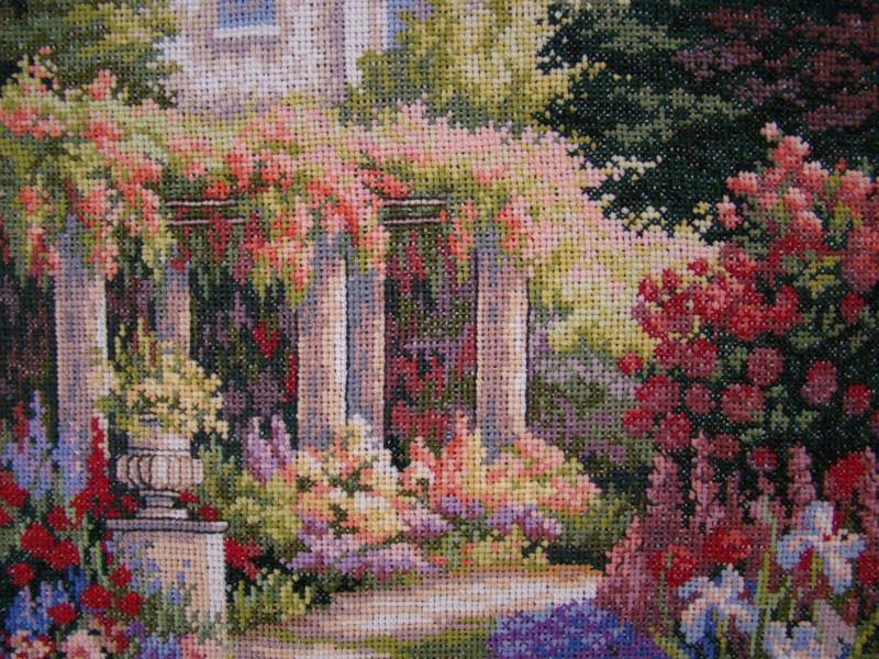 Izšūta glezna ar dārza skatu